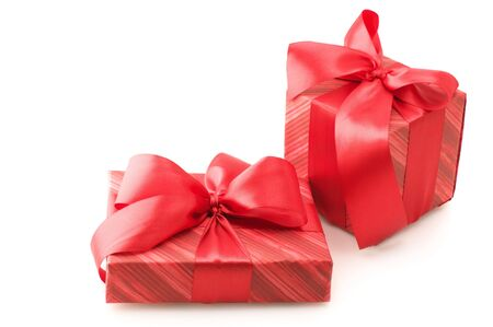 Two red gifts with satin bows isolated on white background. Stock Photo - 5909198