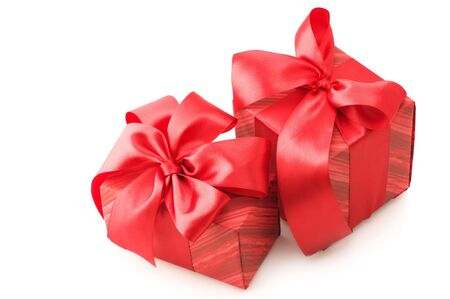 Two red gifts with satin bows isolated on white background. photo