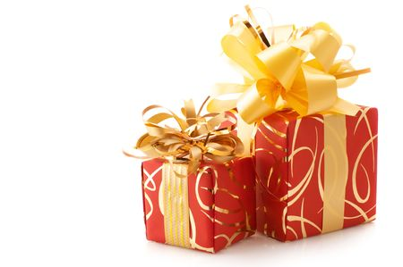 Two red and gold gifts isolated on white background. photo