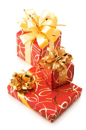 Three red and gold gifts isolated on white background. photo