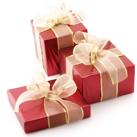 Three red foil gifts with gold translucent bows isolated on white background. photo