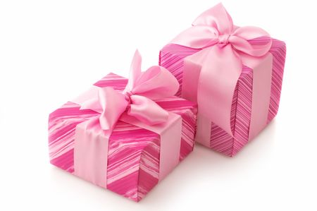 Two pink gifts with satin bows isolated on white background. photo