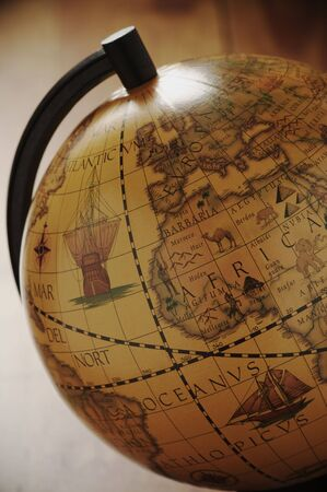 europe closeup: Close-up of vintage globe in back light. Stock Photo