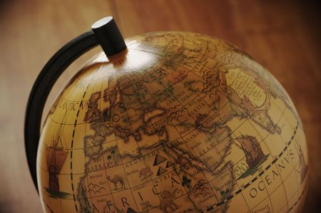 vintage world map: Close-up of vintage globe in back light. Stock Photo