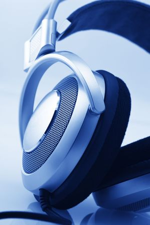 Metallic headphones close-up. Toned monochrome image. Stock Photo - 6484707