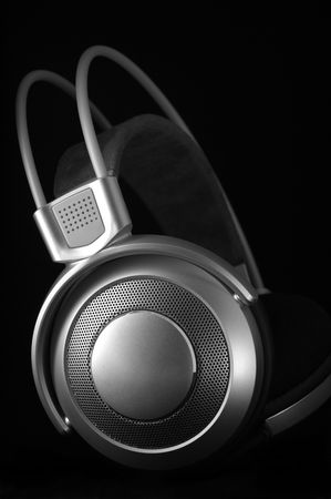 Silver headphones on black background. Stock Photo - 6484712