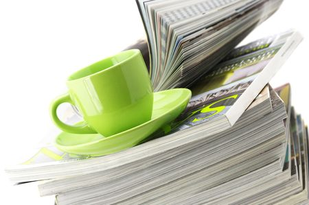 Stack of magazines and green cup of coffee on white background. Stock Photo - 6484791