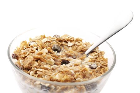 Muesli with milk in glass bowl isolated on white background. photo