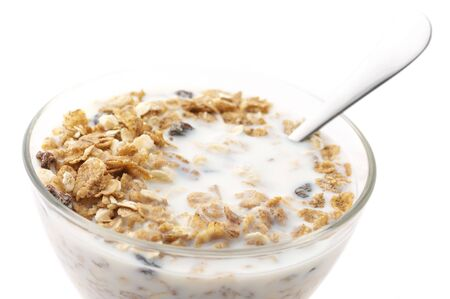 Muesli with milk in glass bowl isolated on white background. Stock Photo - 6974479