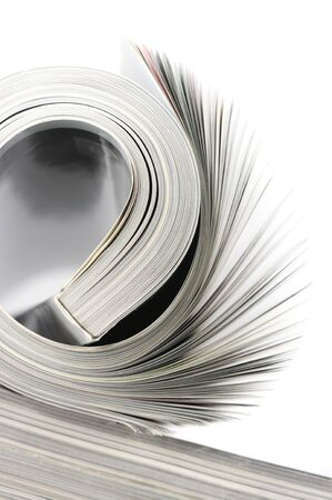 Close-up of rolled magazine isolated on white background. Stock Photo