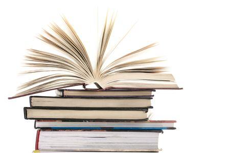 Open book on stack of various books against white background. Stock Photo - 7085131