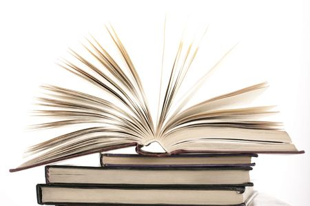 writing book: Open book on stack of various books against white background. Stock Photo