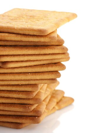 Stack of square crackers close-up on white background. photo