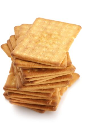 Stack of square crackers isolated on white background. photo