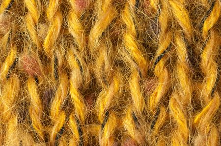 plain stitch: Stockinet of yellow melange mohair yarn close-up. Stock Photo