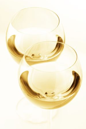 Two glass of white wine close-up on light background. Toned monochrome image. Stock Photo - 7349095
