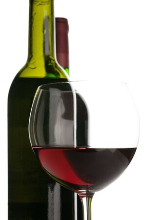 Two bottles and glass of red wine close-up on white background. Stock Photo - 7494887