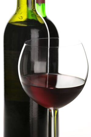 Two bottles and glass of red wine close-up on white background. Stock Photo - 7581900