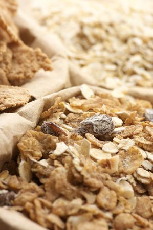 Close-up of various breakfast cereals in paper bags. photo