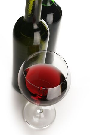 wineglass: Two bottles and glass of red wine on white background.