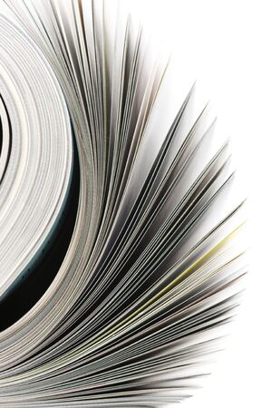 editorial: Close-up of rolled magazine isolated on white background. Stock Photo