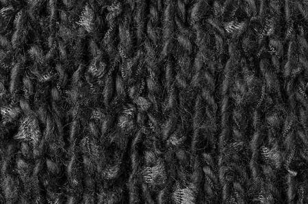 plain stitch: Stockinet of black melange wool yarn as background.