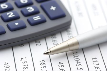 Close-up of silver pen and calculator on paper table numbers. Stock Photo - 7949899