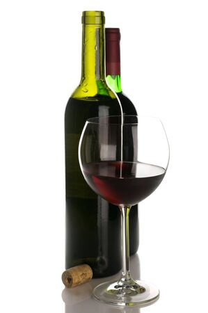 Two bottles and glass of red wine isolated on white background. Stock Photo - 8017558