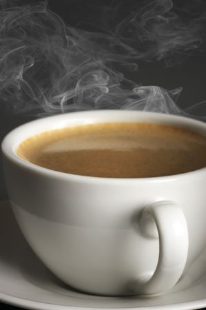 Close-up of white cup of hot coffee with steam on dark gray background. Stock Photo - 8080547