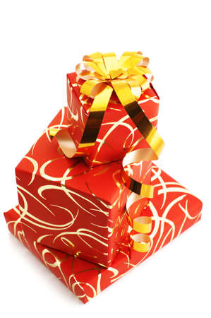 Stack of red gifts with golden ornament isolated on white background. photo