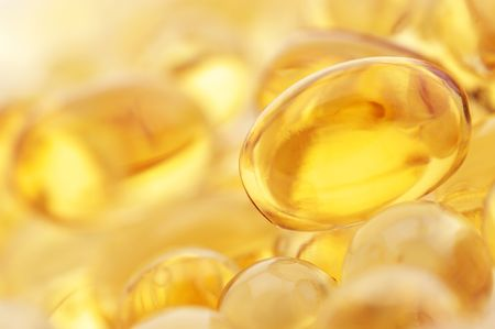 Capsules of fish oil and vitamins close-up. photo