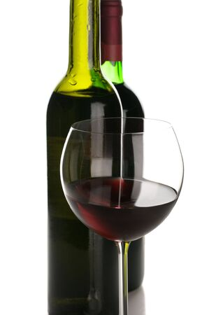 Two bottles and glass of red wine on white background. Stock Photo - 8138655