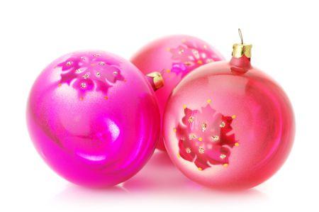 Three pink Christmas balls isolated on white background. photo
