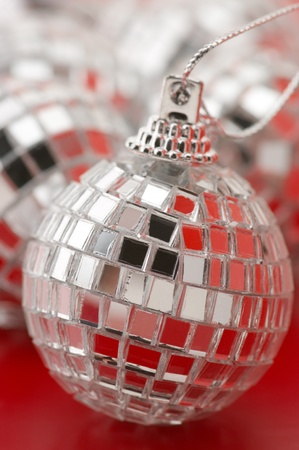 Close-up of Christmas disco balls with red reflections. photo