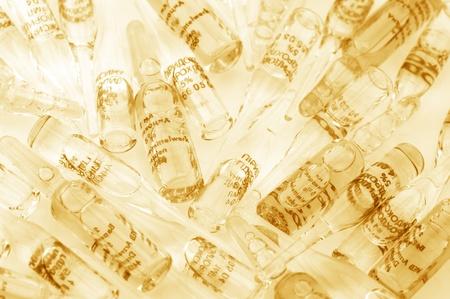 toned image: Ampules as background. Monochrome toned image. Stock Photo