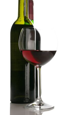 Two bottles and glass of red wine on white background. Stock Photo - 8584744
