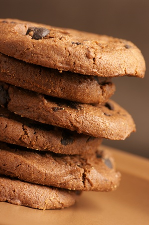 Stack of chocolate cookies with chocolate chips close-up. photo