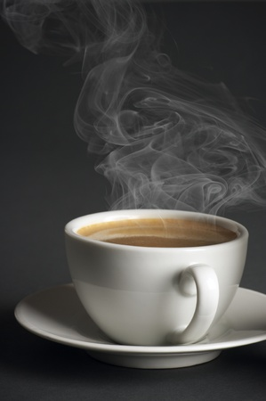 White cup of hot coffee with steam on dark gray background. Stock Photo - 8612794