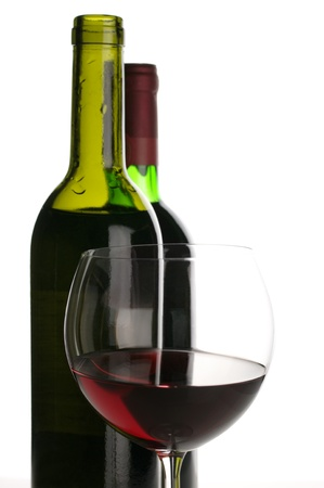 Two bottles and glass of red wine on white background. Stock Photo - 8652301