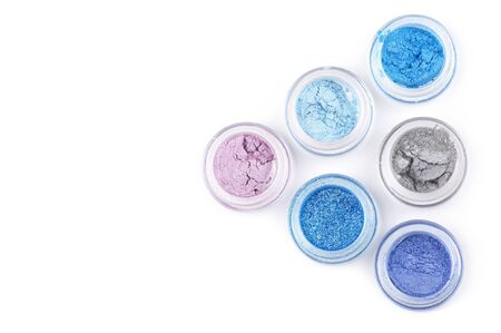 Set of powder eye shadows in jars isolated on white background. Stock Photo - 8708981