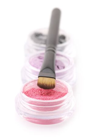 brush in: Set of powder eye shadows in jars with brush isolated on white background. Stock Photo