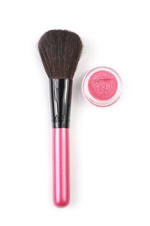 Pink make-up brush and pink powder blush in jar isolated on white background. photo