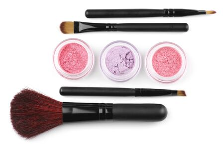 Make-up brushes and powder eye shadows in jars isolated on white background. Stock Photo - 8804629