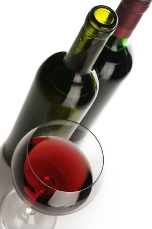 Two bottles and glass of red wine on white background. Stock Photo - 8804619