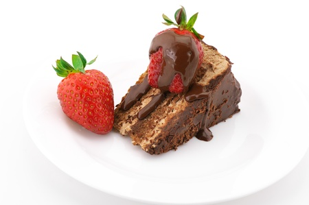 layer cake: Slice of chocolate cake with strawberries in white plate on white background.