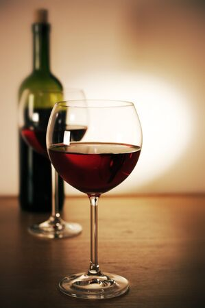 table glass: Two glasses of red wine and wine bottle. Stock Photo