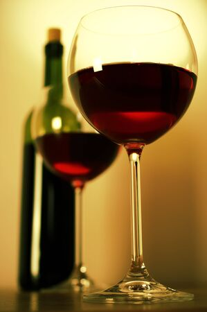 view from below: Two glasses of red wine and wine bottle. Stock Photo