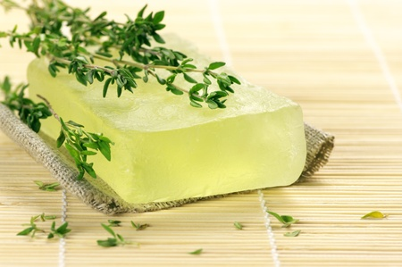 Bar of natural handmade soap with thyme on wooden mat. Stock Photo - 9099283