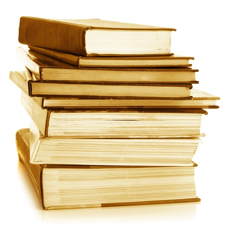 Stack of various books isolated on white background. Toned image. photo