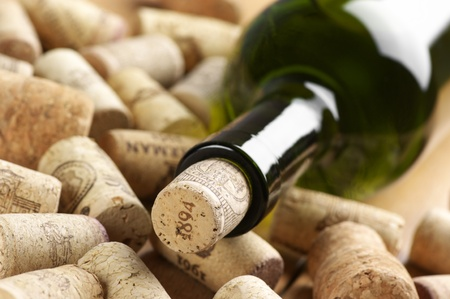 Close-up of closed wine bottle and heap of used. photo